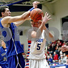 Monica Maschak - mmaschak@shawmedia.com<br /> Genoa-Kingston's Danny Hansen loses control of the ball in the second quarter against Burlington Central on Friday, February 7, 2014. The Cogs lost, 58-49.
