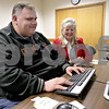 Monica Maschak - mmaschak@shawmedia.com<br /> First Institute Remedial Assessment Specialist Patricia Braksick oversees Willis Yurs, 41, of DeKalb, working on an online tutoring program at Illinois WorkNet Center in DeKalb on Friday, February 14, 2014. When Yurs started the tutoring program, he tested at a 4.6 grade level. Now, after four months, he tests at a 12.9 grade level according to the Test of Adult Basic Education (TABE). Yurs hopes to complete his schooling to be a truck driver and get a job this month.