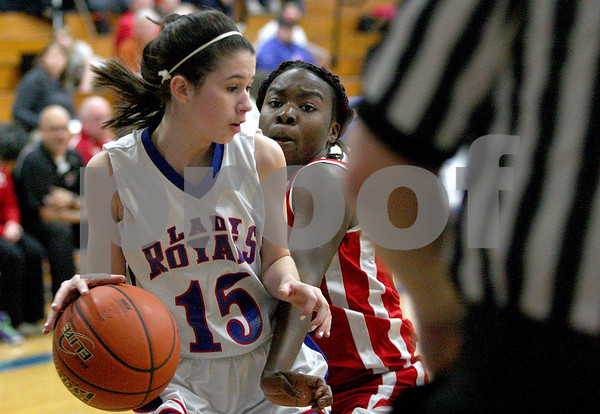 Monica Maschak - mmaschak@shawmedia.com<br /> Hinckley-Big Rock's Lexi Gonzalez collides with a defender in the second quarter against Mooseheart on Tuesday, February 11, 2014. The Royals beat the Ramblers, 52-13.