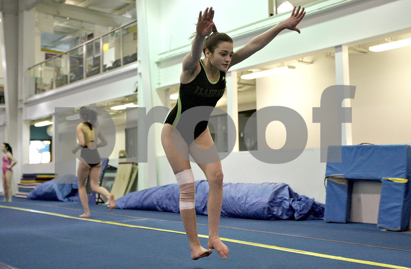Monica Maschak - mmaschak@shawmedia.com<br /> Allison Morreale warms up by tumbling during practice at the Energym on Thursday, February 6, 2014.