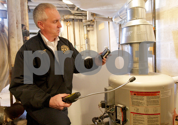 Monica Maschak - mmaschak@shawmedia.com<br /> Sycamore Assistant Fire Chief Art Vern demonstrates how the  four-gas meter and the combustible gas detector monitors the air around a water heater on Tuesday, February 11, 2014. Common areas for carbon monoxide  leaks are around water heaters, furnaces and stoves.