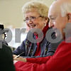 Monica Maschak - mmaschak@shawmedia.com<br /> Marilyn and Merv Mathison, of DeKalb, laugh at a question asked during a newlyweds-type game at a breakfast for couples married 50 years or longer at St. Mary's Memorial Hall in Sycamore on Thursday, February 13, 2014. The Mathisons have been married for 52 years.