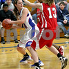 Monica Maschak - mmaschak@shawmedia.com<br /> Hinckley-Big Rock's Anne Klein looks to pass the ball in the third quarter against Mooseheart on Tuesday, February 11, 2014. The Royals beat the Ramblers, 52-13.