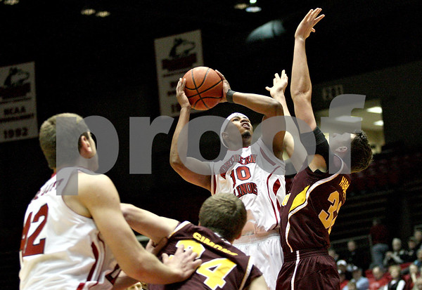 Monica Maschak - mmaschak@shawmedia.com<br /> Northern Illinois' Darrell Bowie shoots for two in the first half against Central Michigan on Wednesday, February 12, 2014. The Huskies won, 88-63.