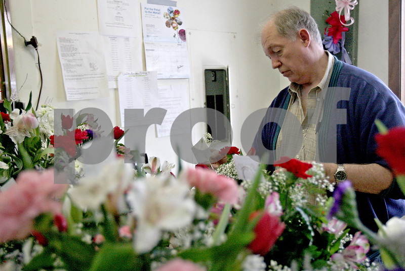 Monica Maschak - mmaschak@shawmedia.com<br /> Floral designer Rod Berg makes a flower arrangement to add to the mass of arrangements in his workspace at Kar-Fre Flowers in Sycamore on Monday, February 10, 2014.