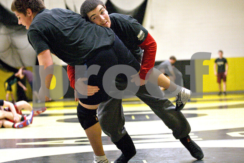 Monica Maschak - mmaschak@shawmedia.com<br /> Austin Armstrong spars with teammate Chris Malone during practice at Sycamore High School on Tuesday, February 11, 2014. Armstrong continues his bid to qualify for the state championship after winning a regional title last weekend.