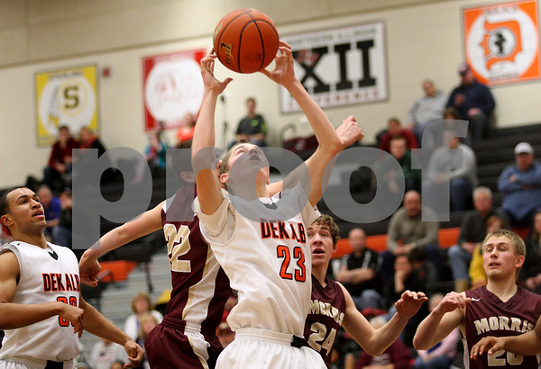 Monica Maschak - mmaschak@shawmedia.com<br /> DeKalb's Jace Kitchen catches a rebound in the second quarter against Morris on Friday, February 14, 2014. DeKalb lost, 47-50.