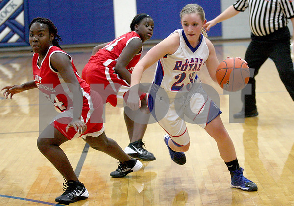 Monica Maschak - mmaschak@shawmedia.com<br /> Hinckley-Big Rock's Andrea Binkley dribbles down the court in the third quarter against Mooseheart on Tuesday, February 11, 2014. The Royals beat the Ramblers, 52-13.
