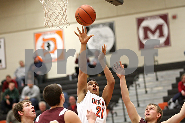 Monica Maschak - mmaschak@shawmedia.com<br /> DeKalb's Rudy Lopez Jr. shoots the ball in the second quarter against Morris on Friday, February 14, 2014. DeKalb lost, 47-50.