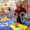 Monica Maschak - mmaschak@shawmedia.com<br /> Preschooler Ashton Grant pieces together a dinosaur puzzle at the Children's Learning Center on Thursday, February 13, 2014.