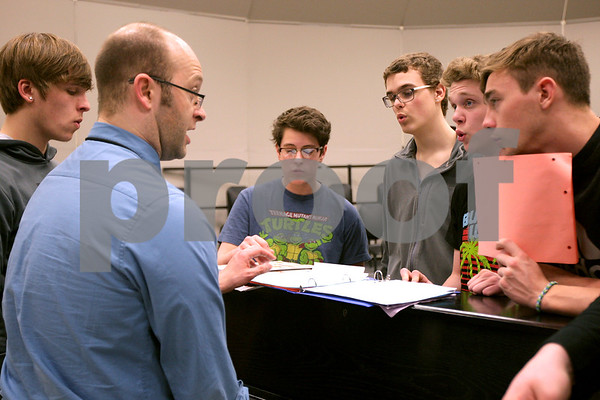 Monica Maschak - mmaschak@shawmedia.com<br /> En Harmonic Fusion's director Travis Erikson goes over notes with the group's basses and baritones during rehearsal at DeKalb High School on Tuesday, February 18, 2014. They will compete this Saturday.