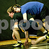Monica Maschak - mmaschak@shawmedia.com<br /> Kyle Akins (top) spars with Logan Mathey during practice at Sycamore High School on Wednesday, February 19, 2014. Akins has a perfect 42-0 on the season and could become the first two-time state champion in school history.