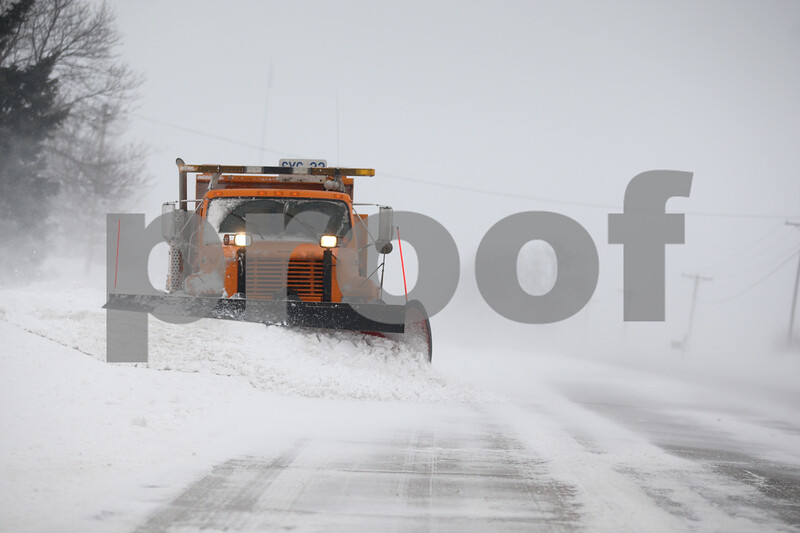 Monica Maschak - mmaschak@shawmedia.com<br /> A plow truck clears a snow drift on Route 23 just south of Route 88 on Monday, February 17, 2014. DeKalb County is expected to receive 4 to 8 inches of snow by 6 p.m. today.