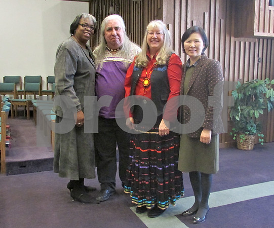Pastor Harlene Harden, Bill Buchholtz, the Rev. Michelle Oberwise Lacock and Pastor GaHyung Kim gather Sunday at the Sycamore United Methodist Church.
