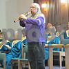 Bill Buchholtz plays the Native American flute on Sunday at the Sycamore United Methodist Church. The church service was focused on educating the congregation on Native American culture.