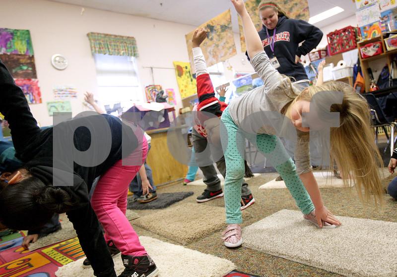 Monica Maschak - mmaschak@shawmedia.com<br /> Preschooler Mallory Lupton and her classmates practice yoga poses at the Children's Learning Center on Thursday, February 13, 2014.