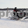 Monica Maschak - mmaschak@shawmedia.com<br /> Darrin Kein, of Maple Park, gets air while  riding his snowmobile in an open field in Sycamore on Tuesday, February 18, 2014.