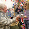 Monica Maschak - mmaschak@shawmedia.com<br /> Preschool teacher Lynn Kohley hands Cassidy Gerken some bookmarks during a good-sportsmanship activity at the Children's Learning Center on Thursday, February 13, 2014.