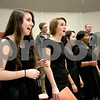 Monica Maschak - mmaschak@shawmedia.com<br /> Nelle Conley (left) and fellow vocalists of En Harmonic Fusion, a DeKalb A Capella group, rehearse at DeKalb High School on Tuesday, February 18, 2014. They will compete this Saturday.