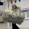 Monica Maschak - mmaschak@shawmedia.com<br /> Teacher Christi Volkening tosses a hay bale during the Ag Olympics at Genoa-Kingston High School on Tuesday, February 18, 2014. The students raised $175.93.
