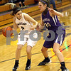 Monica Maschak - mmaschak@shawmedia.com<br /> Sycamore's Morgan Picolotti faces a defender in the second quarter of the Class 3A Regional tournament against Rochelle at Plano High School on Wednesday, February 19, 2014.