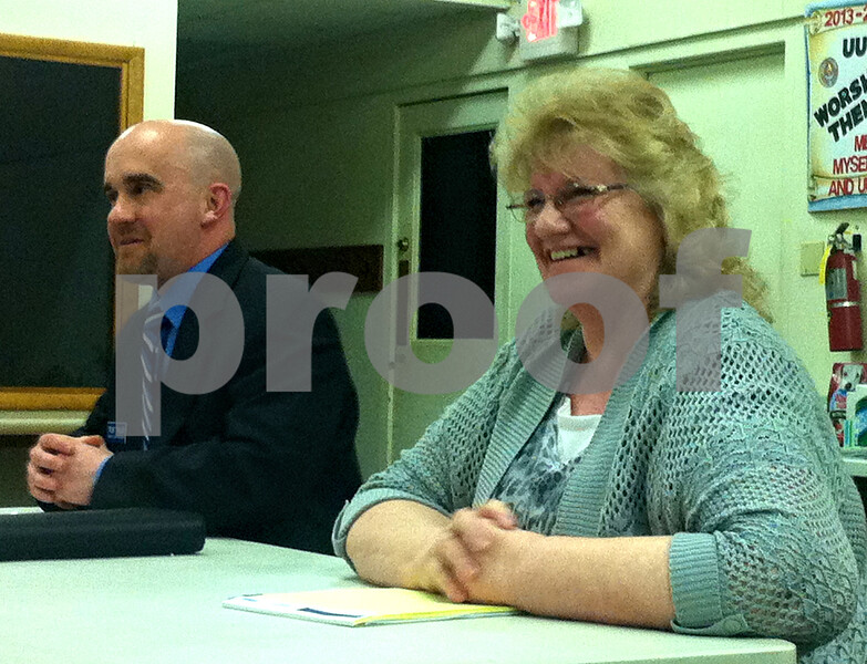 Trent Taylor and Denise Ii, the Democratic candidates for DeKalb County Clerk and Recorder answer questions during a forum held Thursday night at the Unitarian Universalist Fellowship in DeKalb. They will face off in the March 18 primary.