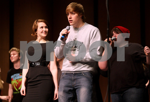 Monica Maschak - mmaschak@shawmedia.com<br /> Samantha Click and Matt Petersen (center), with En Harmonic Fusion, a DeKalb A Cappella group, practice on stage during rehearsal at DeKalb High School on Tuesday, February 18, 2014. They will compete this Saturday.
