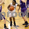 Monica Maschak - mmaschak@shawmedia.com<br /> Sycamore's Taiya Hopkins springs up for the hoop in the first quarter of the Class 3A Regional tournament against Rochelle at Plano High School on Wednesday, February 19, 2014.