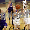 Monica Maschak - mmaschak@shawmedia.com<br /> Sycamore's Julia Moll attempts a field goal in the first quarter of the Class 3A Regional tournament against Rochelle at Plano High School on Wednesday, February 19, 2014.