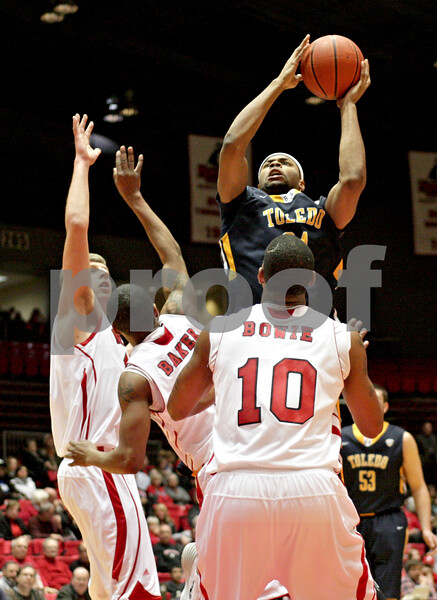 Monica Maschak - mmaschak@shawmedia.com<br /> Toledo's J.D. Weatherspoon attempts a field goal in the first half against Northern Illinois on Wednesday, February 26, 2014. Toledo lost, 74-66.
