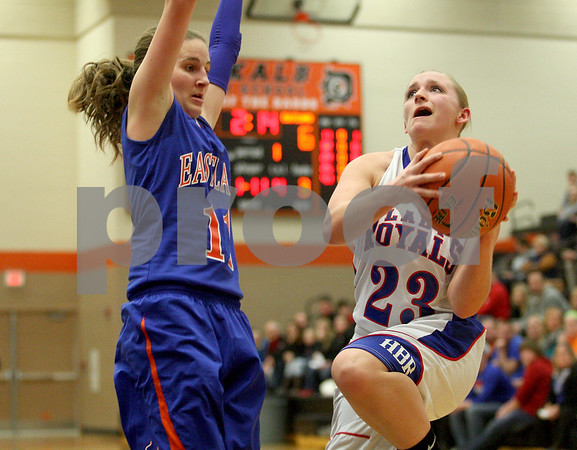 Monica Maschak - mmaschak@shawmedia.com<br /> Hinckley-Big Rock's Andrea Binkley attempts to shoot in the first quarter of the Class 1A DeKalb Super-Sectional against Eastland on Monday, February 24, 2014. The Royals lost, 33-36.
