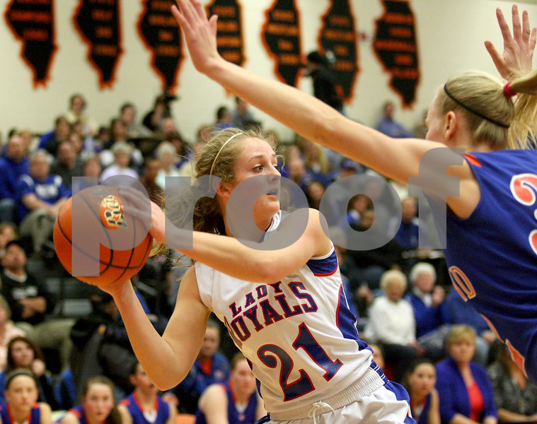 Monica Maschak - mmaschak@shawmedia.com<br /> Hinckley-Big Rock's Lauren Paver looks to make a play in the first quarter of the Class 1A DeKalb Super-Sectional against Eastland on Monday, February 24, 2014. The Royals lost, 33-36.