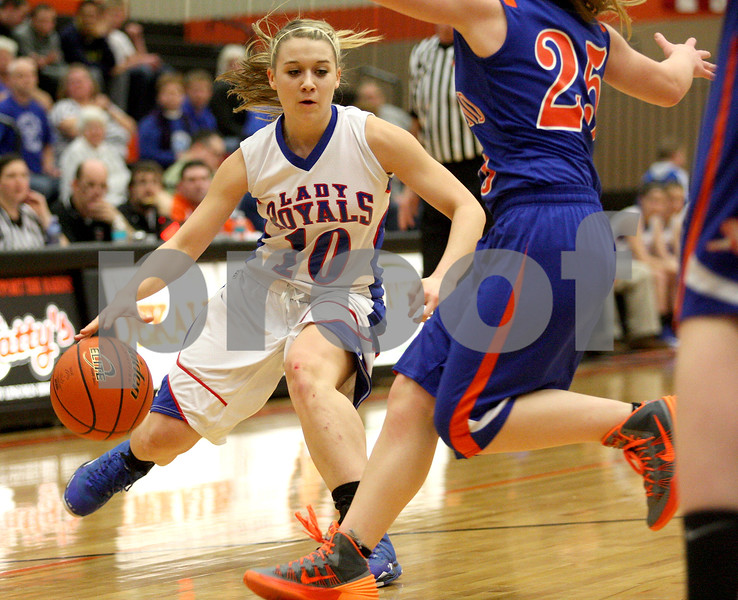 Monica Maschak - mmaschak@shawmedia.com<br /> Hinckley-Big Rock's Jacqueline Madden faces off with a defender in the first quarter of the Class 1A DeKalb Super-Sectional against Eastland on Monday, February 24, 2014. The Royals lost, 33-36.