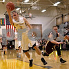Monica Maschak - mmaschak@shawmedia.com<br /> Sycamore's Maxx Miller puts the ball up in the second quarter against Morris on Friday, February 28, 2014. Sycamore won, 60-30.