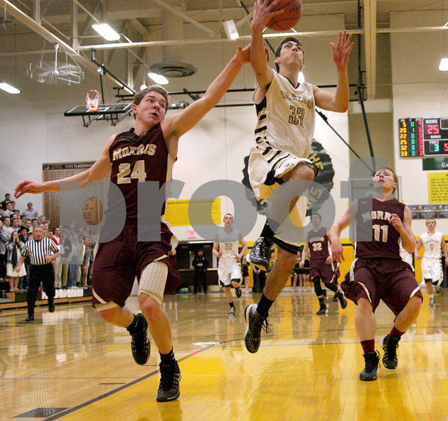 Monica Maschak - mmaschak@shawmedia.com<br /> Sycamore's Mark Skelley shoots the ball in the second quarter against Morris on Friday, February 28, 2014. Sycamore won, 60-30.