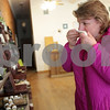 Monica Maschak - mmaschak@shawmedia.com<br /> Peggy LeMieux, of DeKalb, smells a bar of soap at the Two Sisters' Emporium in Sycamore on Thursday, February 20, 2014. LeMieux was looking for a gift for a girls' night party.
