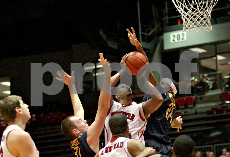 Monica Maschak - mmaschak@shawmedia.com<br /> Northern Illinois' Darrell Bowie puts one up in the first half against Toledo on Wednesday, February 26, 2014. The Huskies won, 74-66.