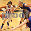 Monica Maschak - mmaschak@shawmedia.com<br /> Hinckley-Big Rock's Lexi Gonzalez dribbles into the zone in the second quarter of the Class 1A DeKalb Super-Sectional against Eastland on Monday, February 24, 2014. The Royals lost, 33-36.