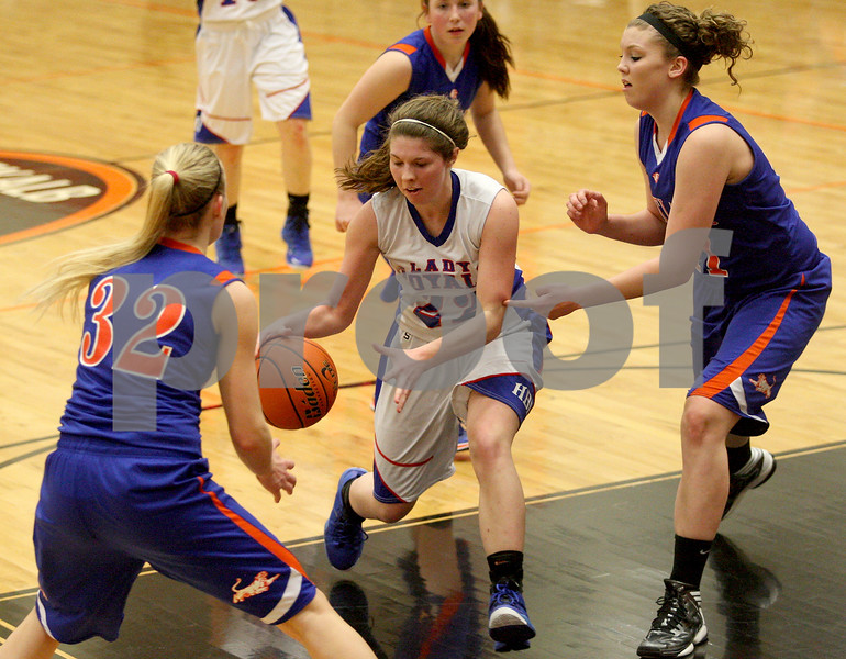 Monica Maschak - mmaschak@shawmedia.com<br /> Hinckley-Big Rock's Caitlin Flanigan finds herself surrounded in the second quarter of the Class 1A DeKalb Super-Sectional against Eastland on Monday, February 24, 2014. The Royals lost, 33-36.