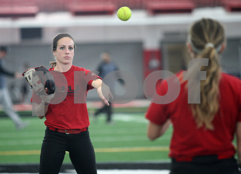 Monica Maschak - mmaschak@shawmedia.com<br /> Nicole Gremillion throws to a teammate during softball practice at the Chessick Center on Tuesday, February 25, 2014.
