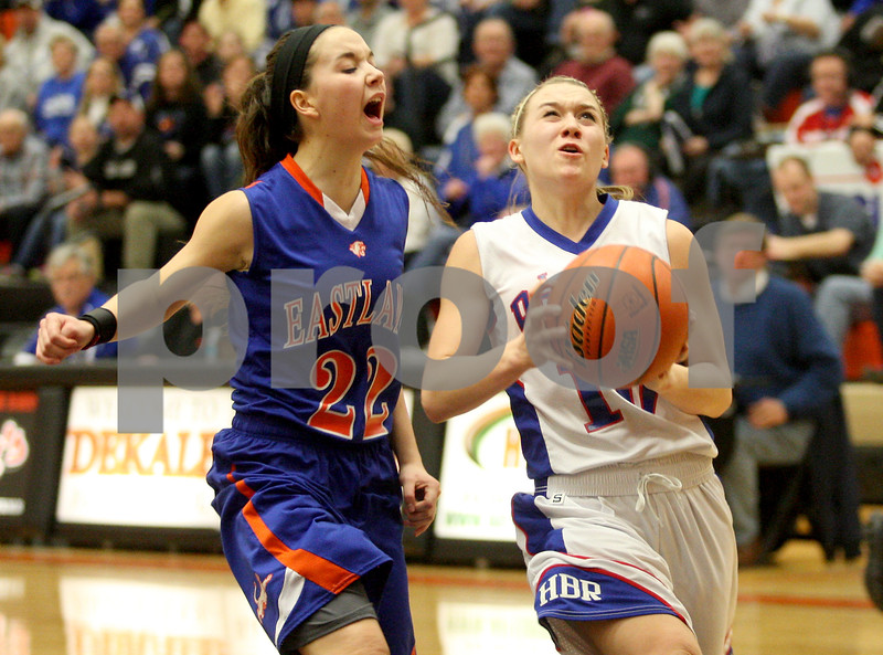 Monica Maschak - mmaschak@shawmedia.com<br /> Hinckley-Big Rock's Jacqueline Madden ignores her defender's distraction in the third quarter of the Class 1A DeKalb Super-Sectional against Eastland on Monday, February 24, 2014. The Royals lost, 33-36.
