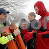 Monica Maschak - mmaschak@shawmedia.com<br /> Firefighter Bill Reynolds (left) helps prepare intern firefighter Evan Rhule for an ice rescue training at Sycamore Park on Thursday, February 20, 2014.