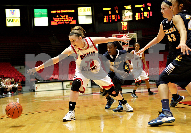 Monica Maschak - mmaschak@shawmedia.com<br /> Northern Illinois' Jenna Thorp reaches for a lost ball in the first half against Toledo on Thursday, February 27, 2014. The Huskies beat the Rockets, 68-50 in overtime.