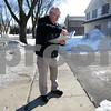 Monica Maschak - mmaschak@shawmedia.com<br /> Crime Free Housing Inspector Mike Stuckert notes code violations on DeKalb rental properties on Tuesday, February 25, 2014. Stuckert makes most of his inspections from the sidewalk.