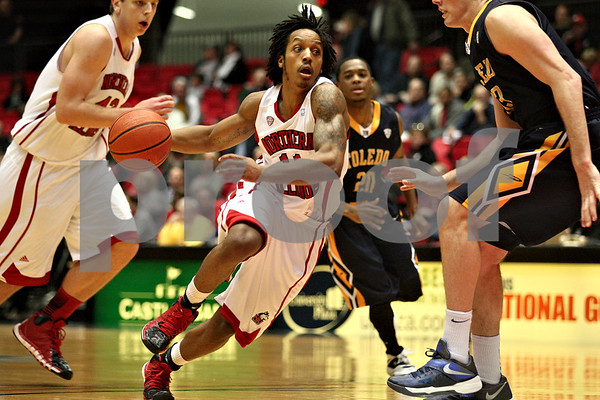 Monica Maschak - mmaschak@shawmedia.com<br /> Northern Illinois' Daveon Balls dribbles down the court in the first half against Toledo on Wednesday, February 26, 2014. The Huskies won, 74-66.