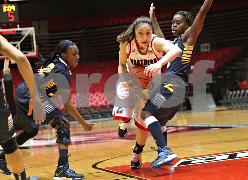 Monica Maschak - mmaschak@shawmedia.com<br /> Northern Illinois' Amanda Corral catches on a defeder's leg in the first half against Toledo on Thursday, February 27, 2014. The Huskies beat the Rockets, 68-50 in overtime.