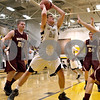 Monica Maschak - mmaschak@shawmedia.com<br /> Sycamore's Ben Niemann eyes the hoop in the second quarter against Morris on Friday, February 28, 2014. Sycamore won, 60-30.