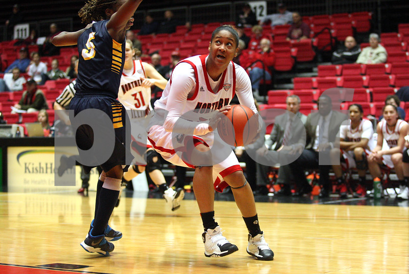 Monica Maschak - mmaschak@shawmedia.com<br /> Northern Illinois' Jazmine Harris prepares to spring for the hoop in the second half against Toledo on Thursday, February 27, 2014. The Huskies beat the Rockets, 68-50 in overtime.