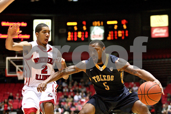 Monica Maschak - mmaschak@shawmedia.com<br /> Toledo's Rian Pearson keeps his defender at arms-length in the first half against Northern Illinois on Wednesday, February 26, 2014. Toledo lost, 74-66.