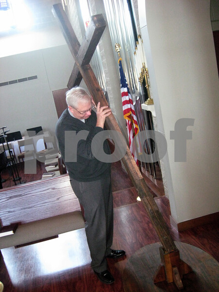 Monica Maschak - mmaschak@shawmedia.com<br /> The Rev. Robert Weinhold peers at a cross at the altar of the Evangelical Lutheran Church of St. John in Sycamore. The cross is part of the chruch's Lenten services, which begin with Ash Wednesday next week.